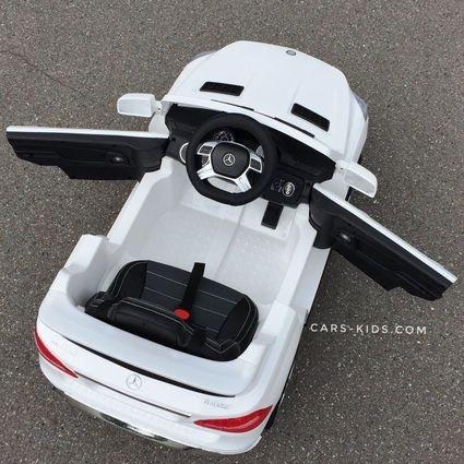 Электромобиль Mercedes Benz ML350 белый (резиновые колеса, кожа, пульт, музыка, глянцевая покраска)